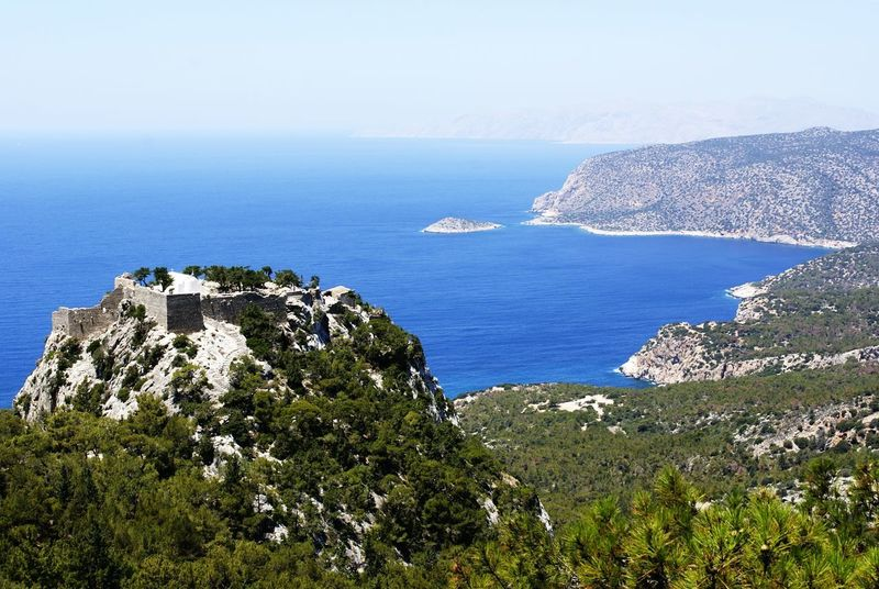 Monolithos Rhodos, Greece  Architecture Beauty In Nature Building Exterior Built Structure Day Horizon Horizon Over Water Land Mountain Nature No People Outdoors Plant Scenics - Nature Sea Sky Tranquil Scene Tranquility Tree Water