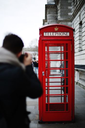Red alert Telephone Booth Red Pay Phone Outdoors One Person Real People Tourism Travel Destinations One Man Only Whitehall London Streets Of London Tourist Tourist Attraction  Iconic Photographer Photographing Man Discovery Telephone Booth Famous EyeEmNewHere This Week On Eyeem Taking Photos Of People Taking Photos