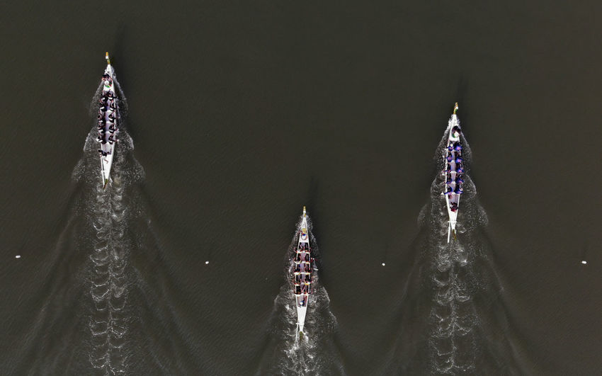 Aerial view of rowboats on lake