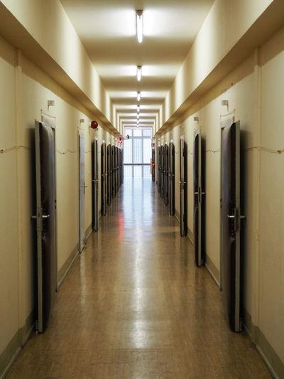 Open Doors At Corridor Of Prison