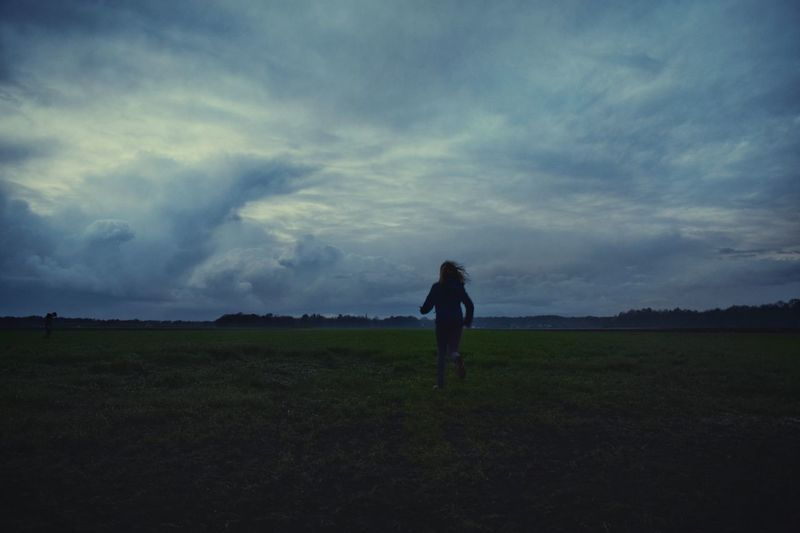 Agriculture Field Rural Scene Outdoors Sky Nature Running Child Running Child Dark Dark Sky Night Sky Rain Clouds Ominous Clouds Ominous Sky Easter Easter Traditions Easter Fire