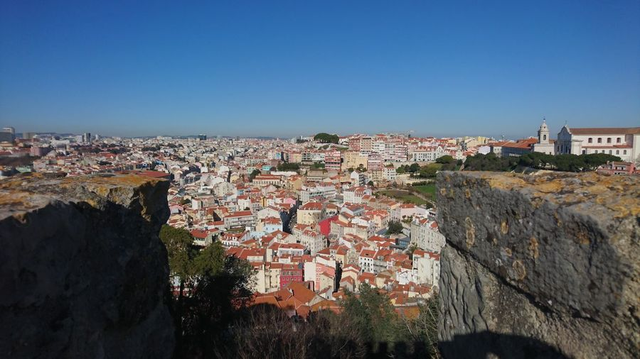 Townscape against clear blue sky