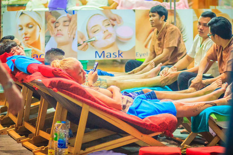 Bangkok, Thailand - March 2, 2017: Foot massage service in spa salon at Khao San Road night market, Bangkok, Thailand. Khao San Rd Khao San Road KhaoSan Khaosan Rd. Khaosandroad Tourist Tourist Attraction  Tourists Adult Arts Culture And Entertainment Chair Crowd Day Enjoyment Foot Massage Foot Massage Foot Massage Area Group Group Of People Innocence Khao San Khao San Knok Wua Khao San Rd. Khaosan Road Khaosanroad Large Group Of People Leisure Activity Lifestyles Males  Men Night Market Night Market In Thailand Night Market, Outdoors Real People Seat Sitting Togetherness Tourist Destination Women