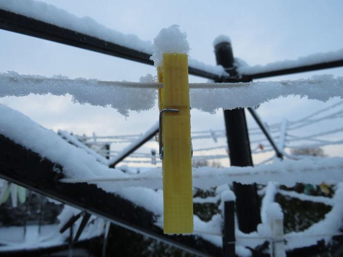 Close-up of snow covered bridge against sky