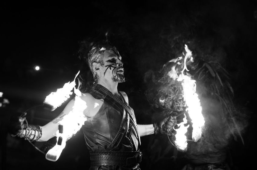 Beltane 2016. Loved how the flames caught the metallic paint in his hair. 2016 Beltane Beltane Fire Festival Black And White Celtic Costume Darkness Edinburgh Festival Fire Fire Dancer K5 Low Light Man Night Pentax People Portrait Portraits Scotland Scottish Tamron The Portraitist - 20I6 EyeEm Awards