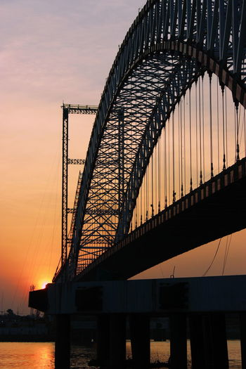 Landscape Photography Buildings & Sky City Sunset Harbor Bridge - Man Made Structure Silhouette Sky Architecture Built Structure Ocean Calm Long Countryside Yellow Line Pathway Contrail White Line