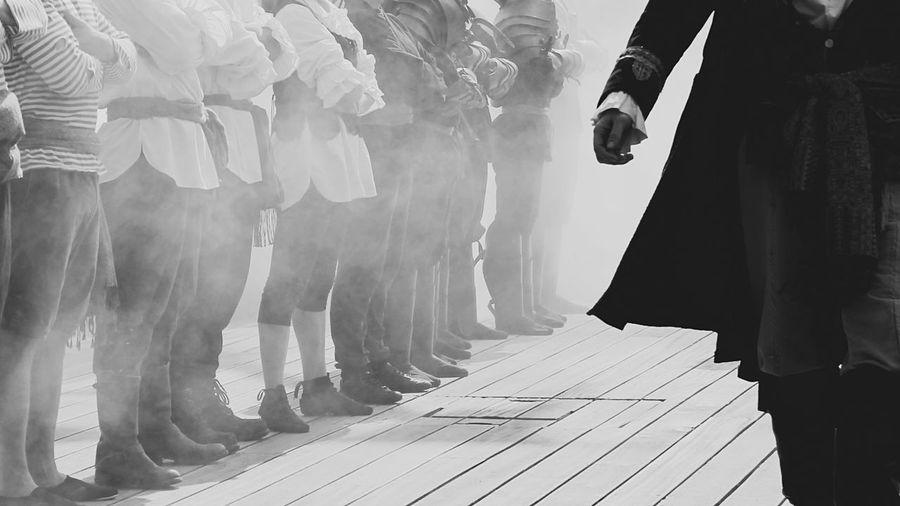 Low section of men standing on floor at heide park