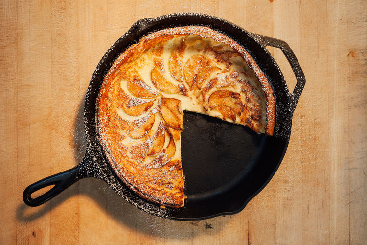 Breakfast apple dutch pancake. Apple Baked Goods Breakfast Cuisine Family Meal Meal Morning Rustic Bakery Brunch Butcher Block Cast Iron Delicious Directly Above Eat Food Fresh Indulgence Kitchen Utensil Pastry Still Life Sunshine Table Temptation Wood - Material