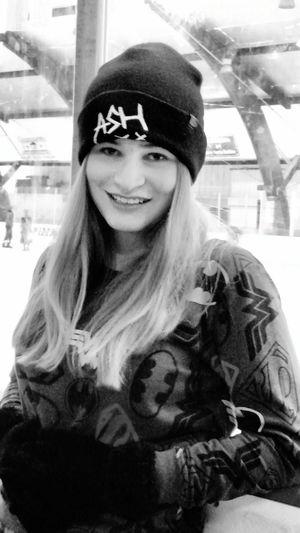 Black white girl ice skate winter hat blonde hair smile warm