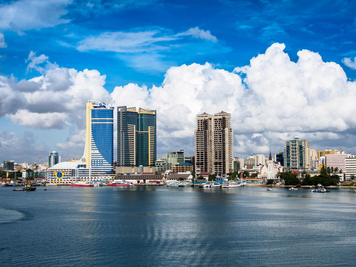 View from sea at Dar es Salaam. Church Tanzania Architecture Building Exterior Built Structure City Cityscape Cloud - Sky Dar Es Sallam Day Dock Downtown District Modern Nautical Vessel No People Outdoors Port Sea Sky Skyscraper Travel Destinations Urban Skyline Water Waterfront