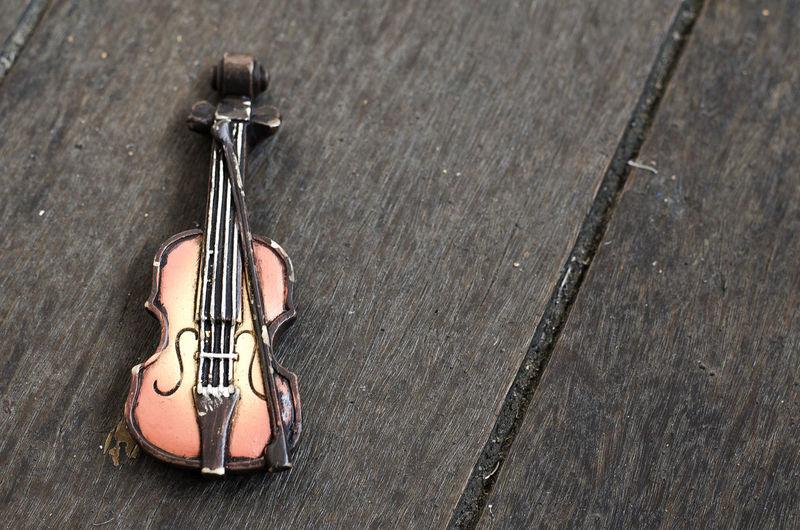 High angle view of figurine violin on table