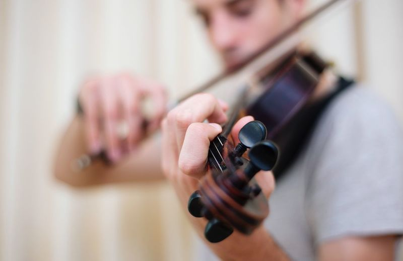 Playing violin Close-up Focus On Foreground Musician Human Hand Playing Violinist Hand One Person Music Musical Instrument