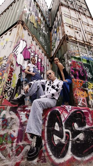 Graffiti Real People Architecture Lifestyles Built Structure Leisure Activity People Building Exterior Wall - Building Feature Men Full Length Adult Day Multi Colored Art And Craft Paint Creativity Street Art