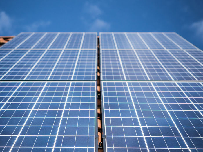 Solar Panel Solar Energy Alternative Energy Fuel And Power Generation Renewable Energy Environmental Conservation Environment Technology Sky Electricity  Power Supply Nature Day Blue Outdoors Sunlight Roof Low Angle View Clean Blue Sky