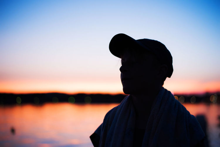 Colourful Hat Sunset Silhouettes Clear Sky Focus On Foreground Headshot Lifestyles Men Nature One Person Outdoors People Real People Reflections Silhouette Sky Sunset