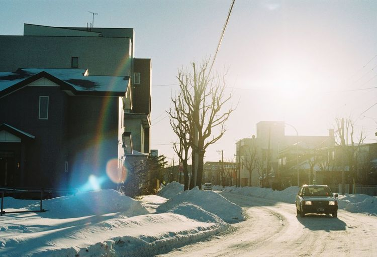 The City Light Cold Temperature Snow Winter Building Exterior Built Structure Sky Environment House City Car Tree Outdoors Land Vehicle Architecture No People Nature Extreme Weather Day Sunset EyeEm Best Shots EyeEm Gallery