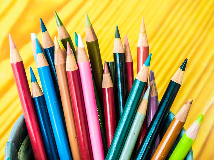 Multicolored pencils are combined in a steel box on a desk in the office. Art Background Blue Bright Brown Closeup College Color Colored Colorful Colors Colour Concept Crayon Crayons Creative Design Draw Drawing Education Equipment Frame Green Group Image Isolated Macro Object Office Orange Paint Palette Pen Pencil Pencils Rainbow Red Row School Set Sharp Stationery Supplies Up Variation Vector White Wood Wooden Yellow Multi Colored Writing Instrument Large Group Of Objects Art And Craft Choice Close-up Colored Pencil Still Life No People Craft Creativity Indoors  High Angle View Art And Craft Equipment Vibrant Color Studio Shot Focus On Foreground Variety