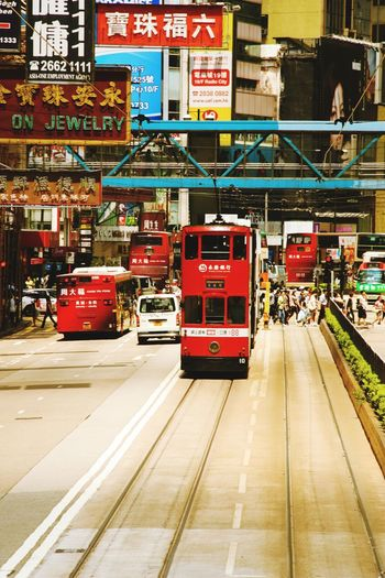 tram Building Exterior Travel Destinations Travel Street Tram HongKong Sightseeing People Crowed City Red Double-decker Bus Public Transportation Fire Engine Road City Street Bus Land Vehicle Street Track Tramway