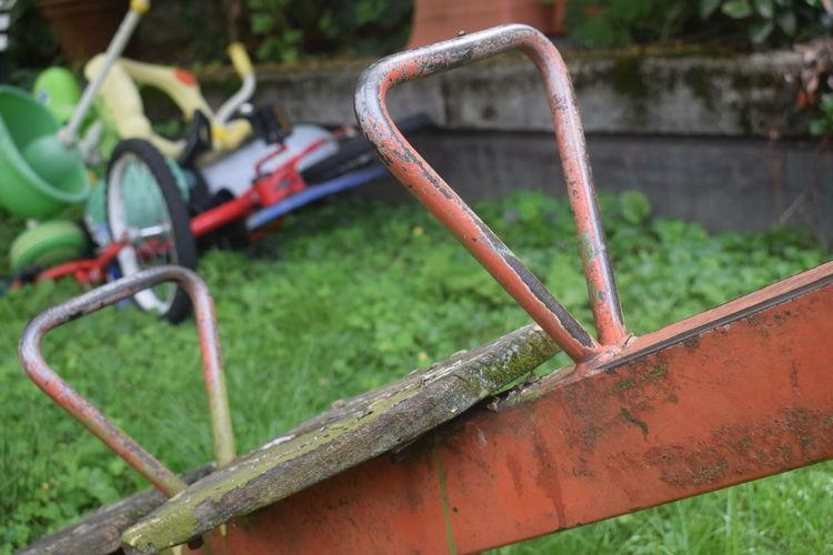 Close-up of rusty playground equipment whip children
