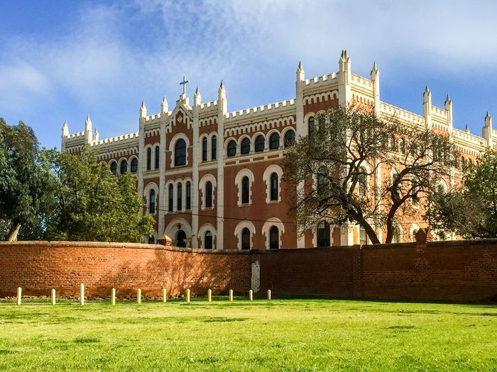 St. Gertrude's: New Norcia Australia Historic Monastic Town New Norcia Western Australia Architecture Building Exterior St. Gertrude's Ladies College Grandiose Spanish Gothic Boundary School Boarding School Outdoors Tourist Attraction  Ornate Red White Moulding