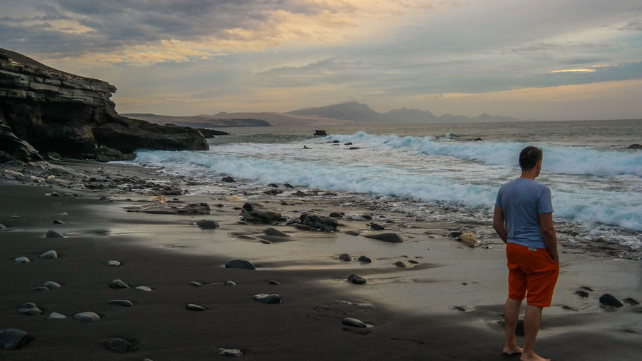 Evening by the sea Evening By The Sea EyeEmNewHere Fuerteventura Lost Lost In The Landscape Beach Beauty In Nature Full Length Horizon Over Water Lifestyles Men Nature One Person Outdoors People Real People Rear View Sand Scenics Sea Sky Standing Sunset Water Wave