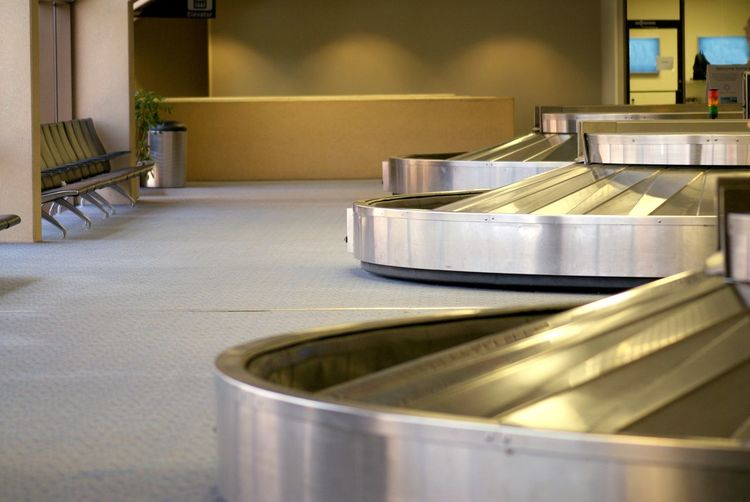 Empty baggage claim at an airport Airport Baggage Baggage Claim Indoors  Metal No People Terminal Travel