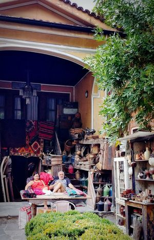PLOVDIV, BULGARIA, SEPTEMBER 2017:A antique shop couple owners were welcoming to their shop for wandering and photographing. Antique Shop Antique Antiques Market Antiquestore Antiquecollection Bułgaria Antique Shopping Tourism Attraction Architecture Market Day Building Exterior Tree