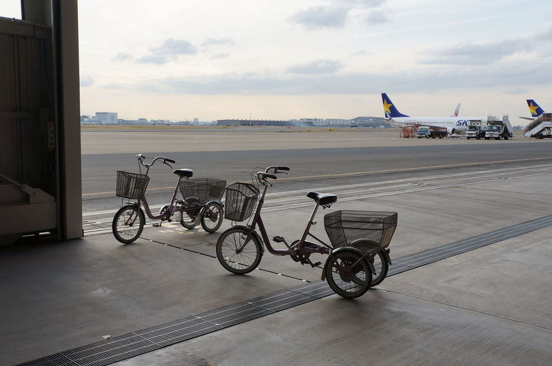 Tricycles At Airport Against Sky During Sunset