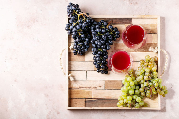 Directly above shot of grapes in glass on table