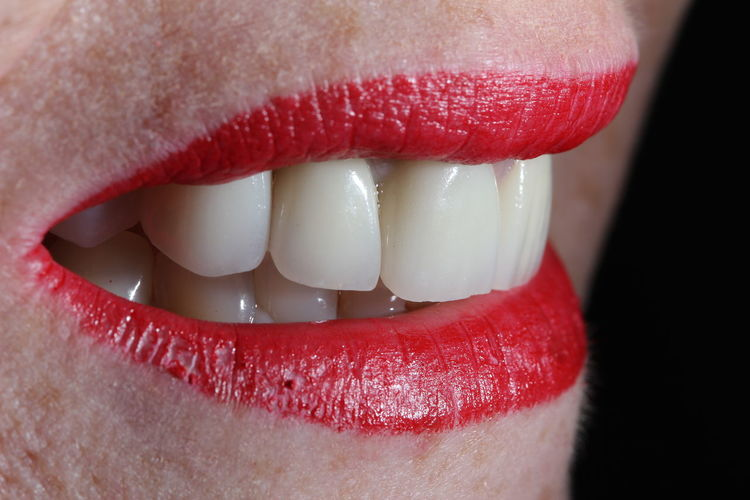 Close-up of woman wearing red lipstick