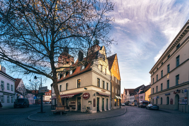 Historic building in Ingolstadt downtown hosts a scenic bar Bare Tree Light Ambient Cold Temperature Vivid Building Exterior Architecture Built Structure City Tree Building Sky Nature Street Cloud - Sky Residential District Plant No People Transportation Day Road Outdoors Mode Of Transportation