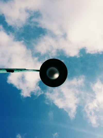 Directly Below Shot Of Street Light Against Sky
