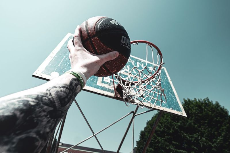 Basketball Human Hand Hand Sky Human Body Part One Person Nature Leisure Activity Low Angle View Personal Perspective Body Part Real People Outdoors Amusement Park Ride Lifestyles Day Architecture Holding Sport Amusement Park Finger