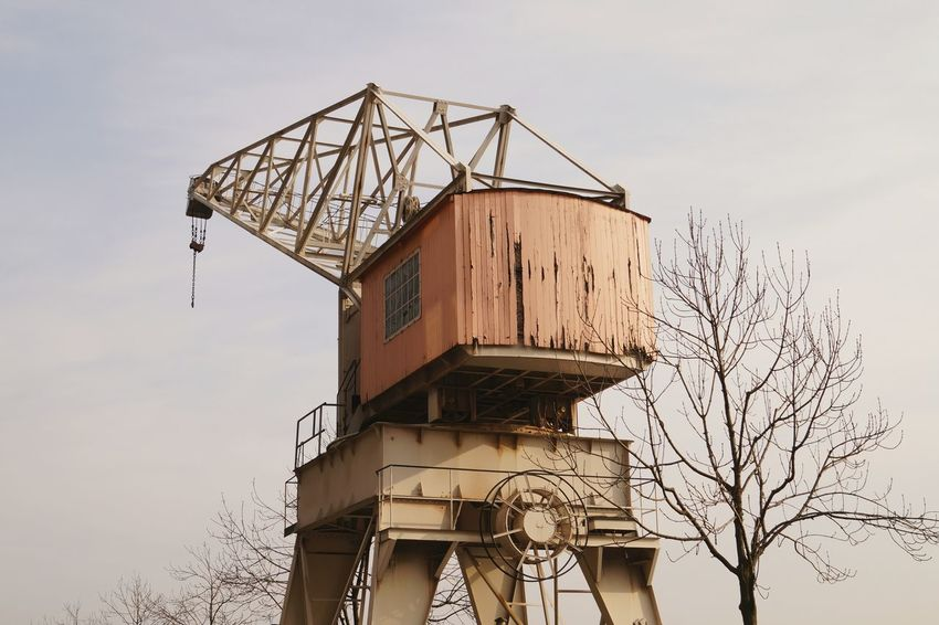 today my favorite shot No People Winter Dusgiganten Built Structure Architecture Vintage Crane Port Harbor Light Colors River Industry Trees Weathered Spalling Window Sky Cropped Minimalist Architecture Minimalism Facades Looking Up Pink Old Things The Architect - 2017 EyeEm Awards