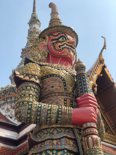 Low Angle View Of Statue Against Temple