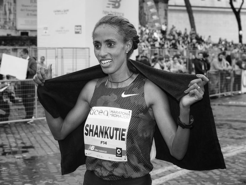 Rome, Italy - April 2, 2017: Shankutie Mestawot Tadesse won the second place in the women's race, the 23rd Rome Marathon. Shankutie on his arrival at the finish line. Adults Only Athlete; Blackandwhite City Day Ethiopian; One Person Only Women Outdoors People Portrait Runner Shankutie Smiling