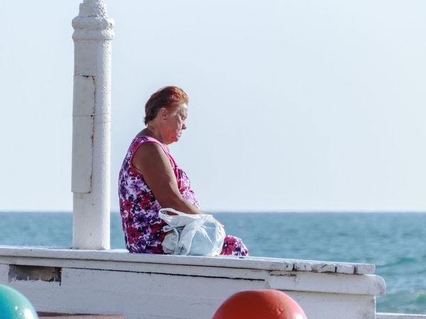 Nahariya, Israel - May 30, 2016: Elderly woman relaxing at sunset on the beach in Nahariya, Israel Adult Beach Blue Colored Elderly Females Horizon Over Water Israel Leisure Lifestyles Nahariya Nature Old Outdoors People Relaxation Relaxing Retirement Sea Seniors Sitting Sky Sunset Water Woman