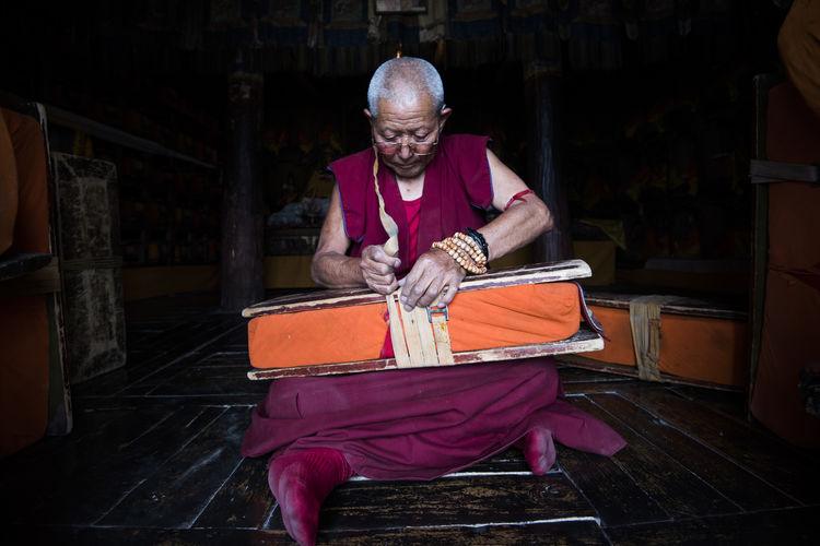 Monk  Librarian Leh Ladakh Portrait Indoor Lowlight People Thiksey Monastery Millennial Pink The Portraitist - 2017 EyeEm Awards