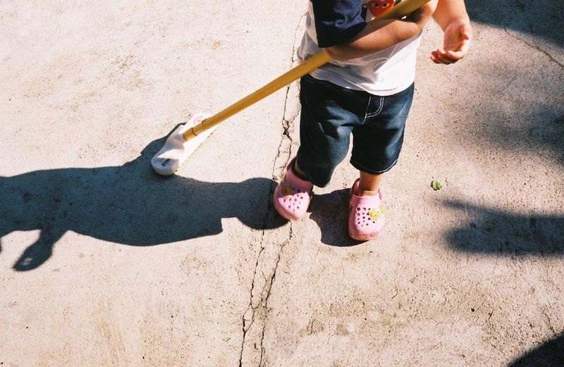 Sweeping. Child