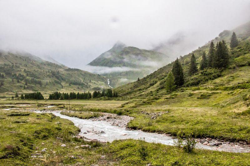 Stream flowing through a mountain