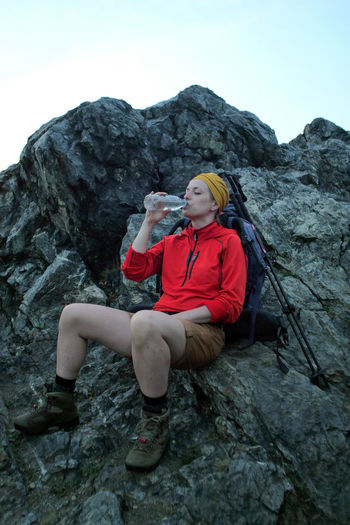 female hiker drinking water Alpine Backpacking Boots Camping Expedition Freedom Hiking Hydration Travel Trekking Woman Active Activity Adventure Backpack Bottle Casual Clothing Caucasian Climbing Day Drinking Female Fitness Full Length Leisure Activity Lifestyles Mountain Mountain Range Nature One Person Outdoors People Real People Rock Rock - Object Rock Formation Sitting Solid Trail Water Women Young Adult