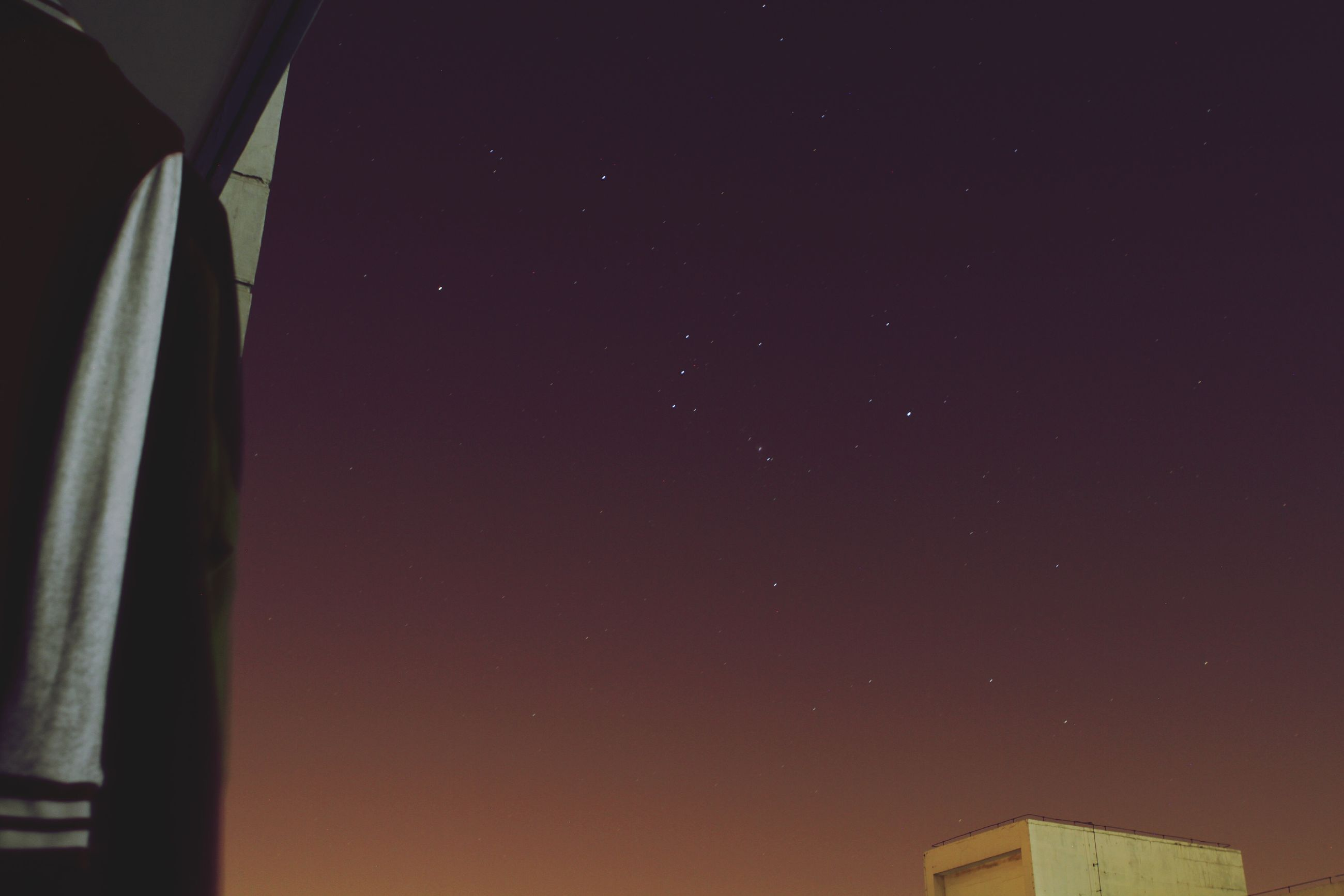 low angle view, night, sky, copy space, moon, built structure, architecture, astronomy, building exterior, clear sky, no people, high section, nature, scenics, star - space, dark, beauty in nature, outdoors, tranquility, illuminated