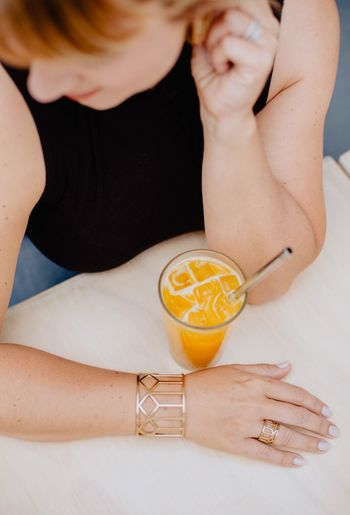 Midsection of woman drinking glass