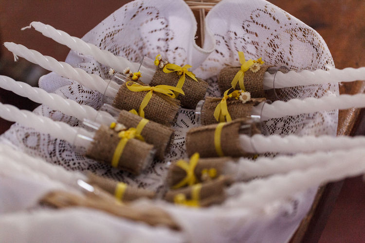 Close-up of candles on lace during holy communion