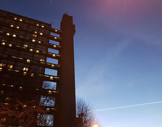 Trellick Tower Business Finance And Industry Low Angle View Architecture Sky No People Blue Built Structure Skyscraper Outdoors City Building Exterior Night Brutalism Goldfinger