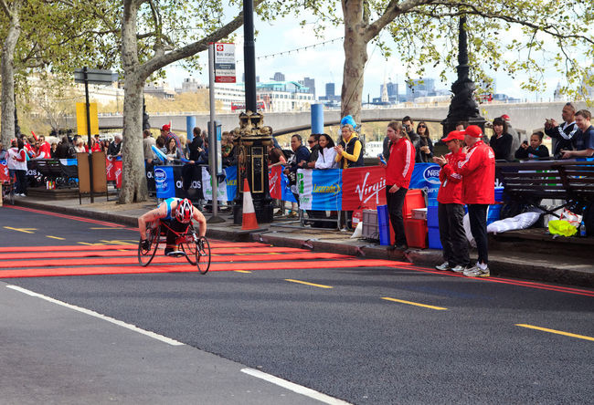 Wheelchair racer at 32nd London's Marathon, London, UK 2012 Adult Adults Only City City Life Crowd Day Large Group Of People London London Marathon Marathon Marathonrunner Men Outdoors Parade Paralimpics People Real People Street Streetphotography Tree Uk Virgin  Wheelchair Women