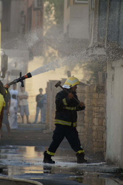 fire City Full Length Men Standing Occupation Architecture Sky Fire Hose Fire Extinguisher Rescue Worker