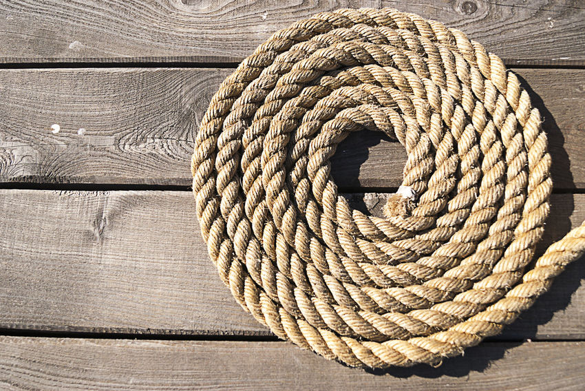 Backgrounds Brown Circle Close-up Concentric Full Frame Geometric Shape Indoors  Intricacy Man Made Object Pattern Rolled Up Rope Rope Art Single Object Spiral Still Life Textured  Twisted Wicker Wood - Material Wood Grain Wooden Woven