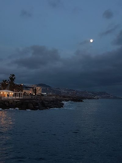 Sea Night Outdoors Landscape Beach Building Exterior Sky Moon Cityscape Vacations Water Nature