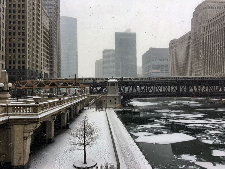 Snow covered riverwalk along the Chicago River, which is filled with ice chunks on a frigid day. Frozen Ice Tree Architecture Bridge - Man Made Structure Building Exterior Built Structure City Cityscape Cold Temperature Connection Day Frigid Ice Chunks Modern Nature No People Outdoors River Skyscraper Snow Snowing Water Weather Winter